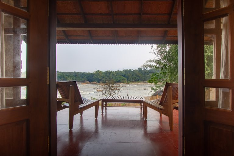 Quiet by the river, CGH Earth - riverside retreat- view from the room